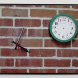 Wayward Hands on Brick Wall